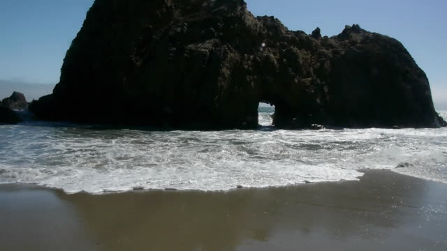 WS Waves crashing through & around Keystone Arch at Pfeiffer Beach, Big Sur, California, USA