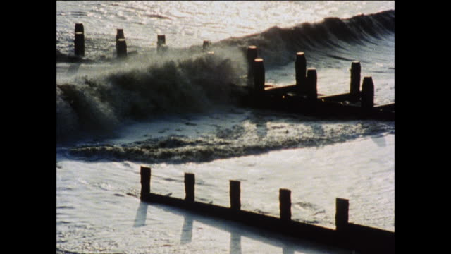 montage waves crashing upon seawalls and other man-made defenses / united kingdom - peter greenaway stock videos & royalty-free footage