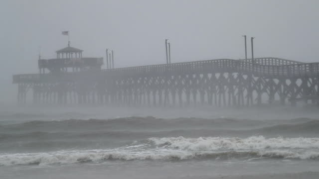 waves created by hurricane florence are seen along cherry grove fishing pier on september 14 2018 in myrtle beach united states hurricane florence is... - carolina beach stock videos and b-roll footage