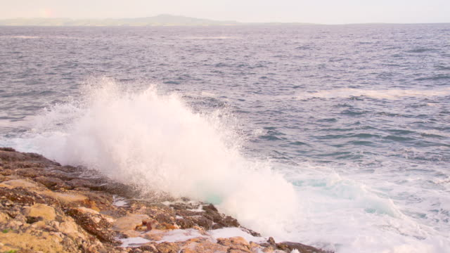 slo mo waves crushing against rocky shore - rocky coastline stock videos & royalty-free footage