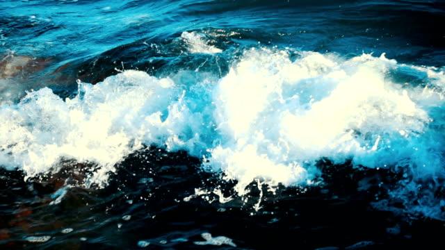 waves crushing rocks - hitting stock videos & royalty-free footage