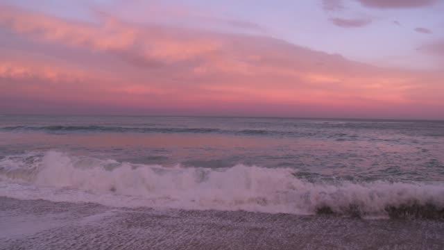 Waves drift onto a beach in Biarritz, France.