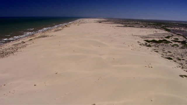waves from the sea of cortez roll onto a long stretch of beach along the california coastline. available in hd. - sea of cortez stock videos & royalty-free footage