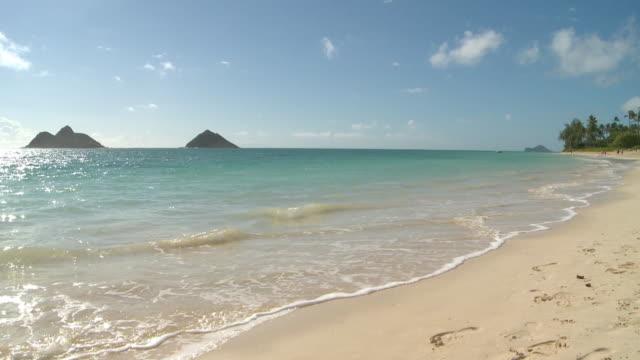 Waves gently wash in Honolulu, Hawaii