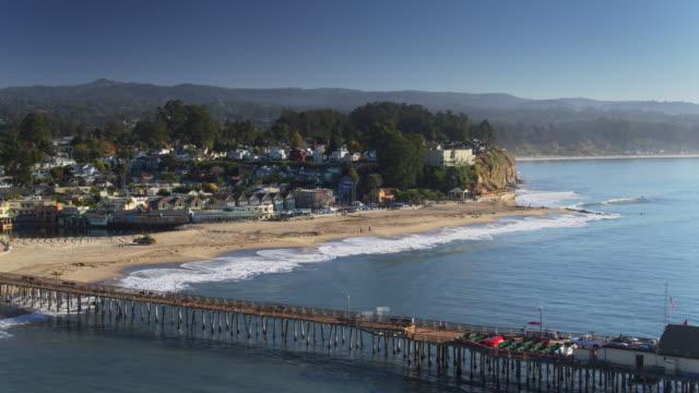 waves hitting beach and cliffs of capitola - santa cruz county california stock videos & royalty-free footage
