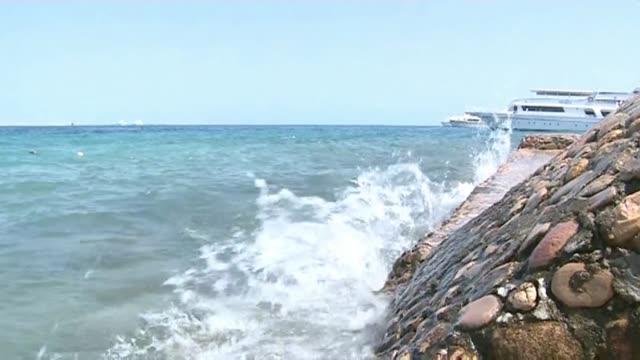 waves hitting breakwater - red sea stock videos & royalty-free footage