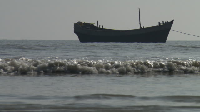 waves lap onto a beach at sagar island. - surface level stock videos & royalty-free footage