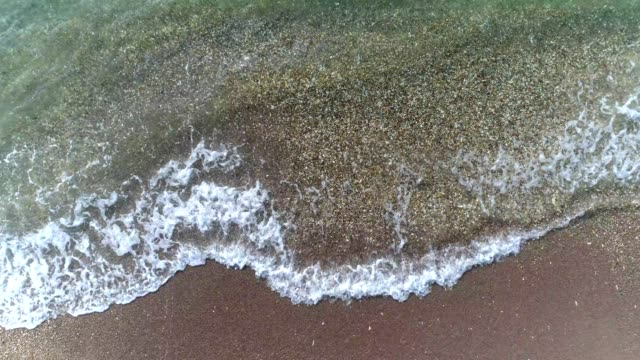 waves lapping at the sea shore - shallow stock videos & royalty-free footage
