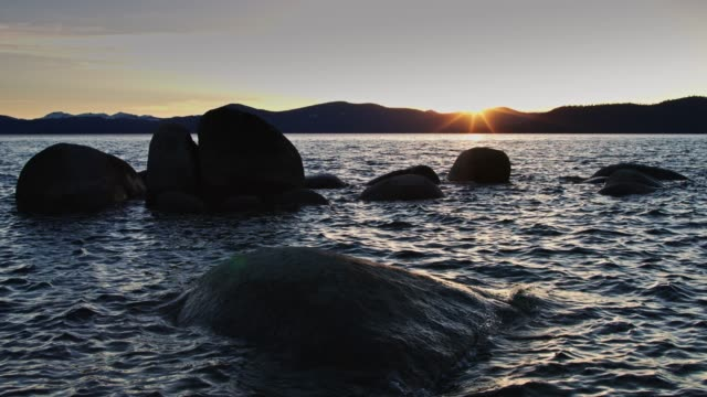 waves lapping bolders in lake tahoe - state park stock videos & royalty-free footage