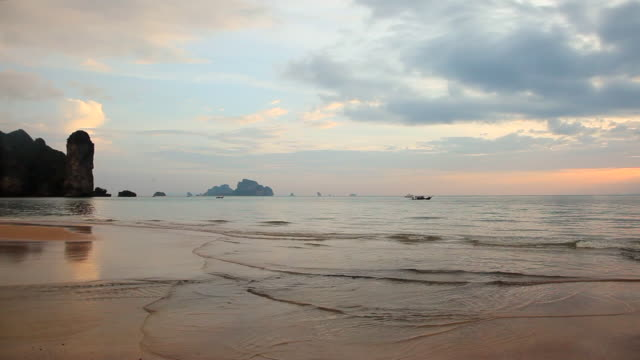 Waves Lapping on the Shore at Krabi Bay at Sunset