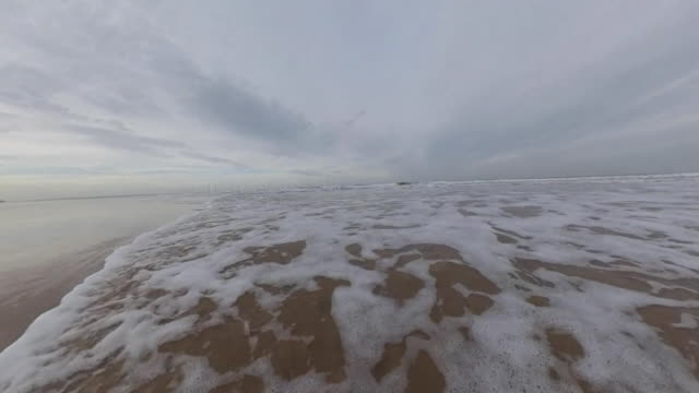 waves lapping redcar beach - north sea stock videos & royalty-free footage