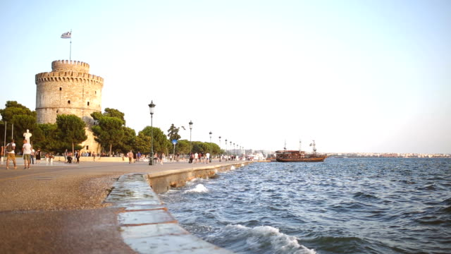 waves near white tower in thessaloniki, greece - thessalonika stock videos & royalty-free footage