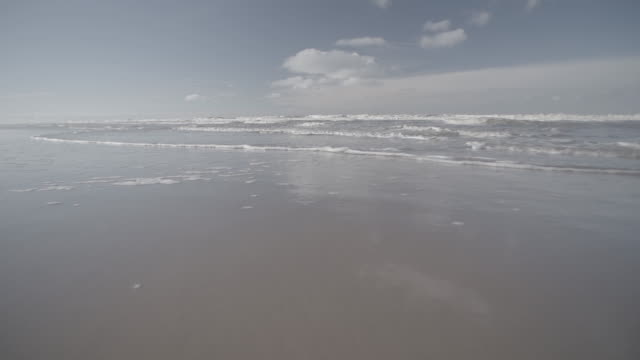 w/s slomo waves northern sand beach low tide - low tide stock videos & royalty-free footage