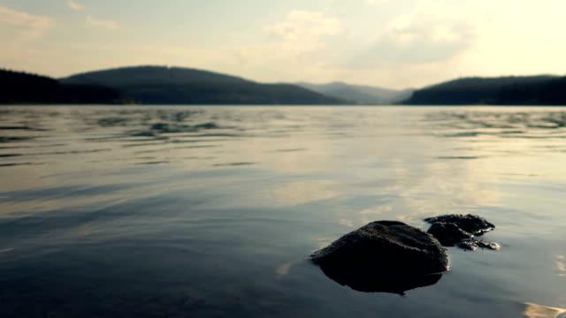 vídeos de stock e filmes b-roll de waves of a lake concept - stock video - reflection