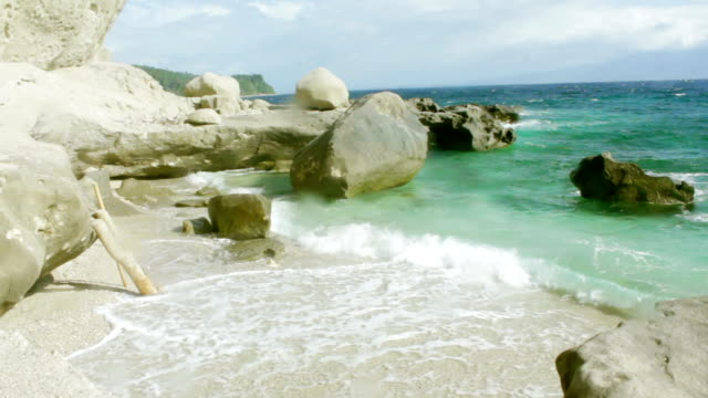 waves of beach water at the lagoon on a very sunny day - batangas province stock videos and b-roll footage