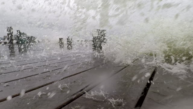 Waves of sea water splash over the camera at a marina in Suffolk County Long Island during a powerful coastal nor'easter