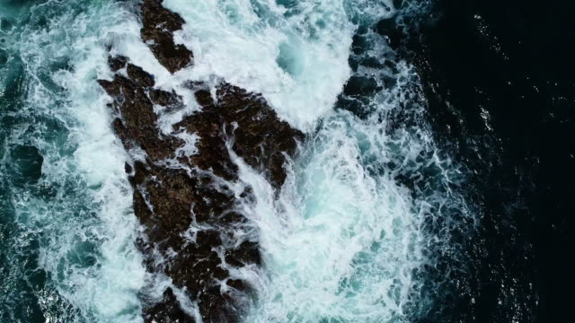 waves on a rocky beach - cliff stock videos & royalty-free footage