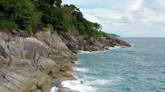waves on a rocky beach - rock object stock videos & royalty-free footage