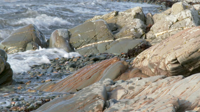 waves on a rocky scottish shore - johnfscott stock videos & royalty-free footage