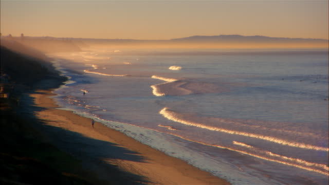 ha, ws, waves on beach at sunset, carlsbad beach, california - carlsbad california stock videos & royalty-free footage
