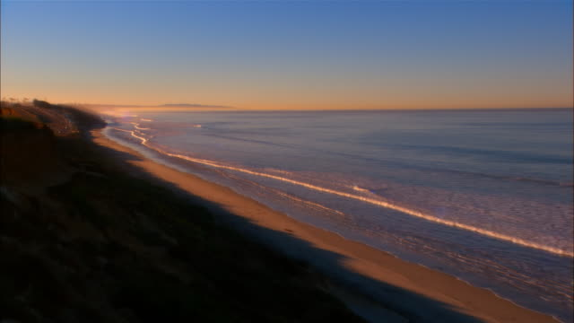 ha, ws, cs, waves on beach at sunset, carlsbad beach, california - carlsbad california stock videos & royalty-free footage