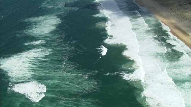aerial, waves on beach near great dune of pilat, aquitaine, france - aquitaine stock videos and b-roll footage
