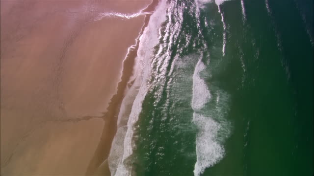 aerial, waves on beach, perrand bay, cornwall, england - cornwall england stock videos & royalty-free footage