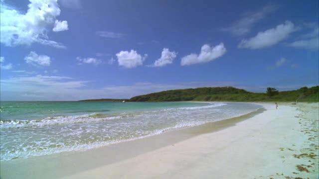 ws, waves on beach, vieques, puerto rico - okänt kön bildbanksvideor och videomaterial från bakom kulisserna
