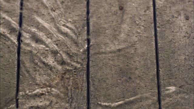 SLO MO CU Waves on iron surface / Vienna, Austria