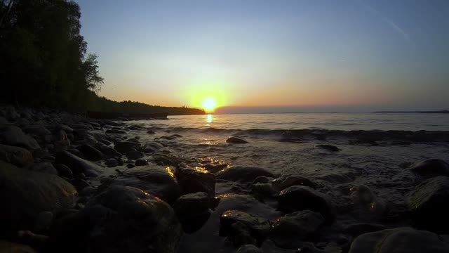waves on lakeshore at sunset - lakeshore stock videos & royalty-free footage