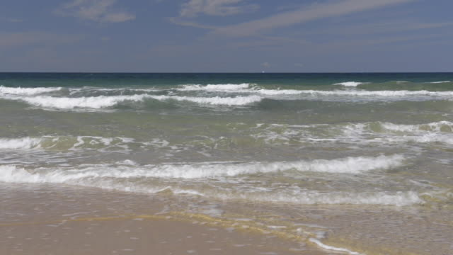 Waves on sandy beach at Cote Sauvage