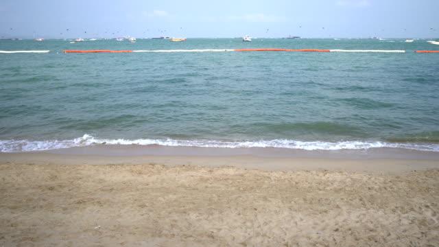 Waves on the beach crashing on sandy shore
