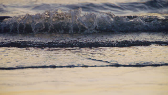 slo mo. waves ripple and break on the beach with the tide. - pacific ocean stock videos & royalty-free footage