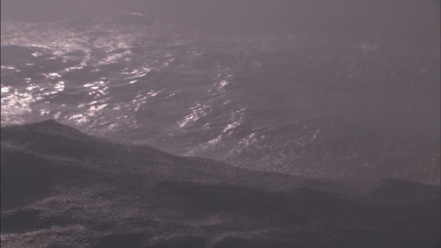 waves roll and heave during a storm. - roh stock-videos und b-roll-filmmaterial
