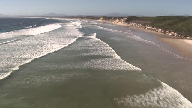 waves roll in onto coast, tasmania - coastline stock videos & royalty-free footage