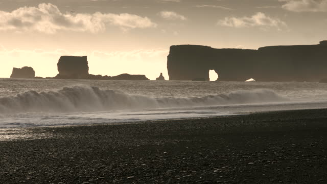 Waves roll onto a beach in southern Iceland.