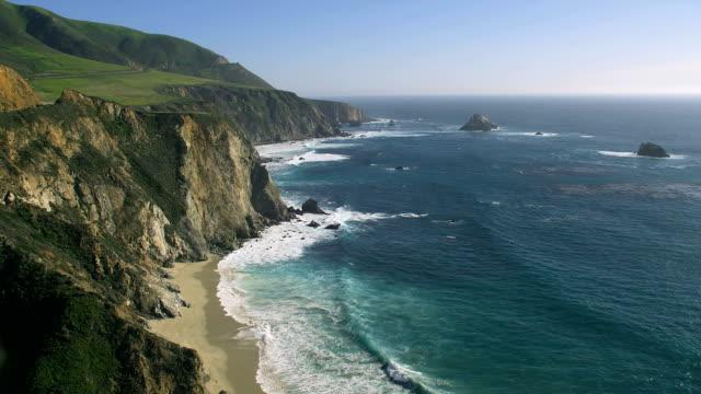 Waves roll onto Big Sur's rugged coast.