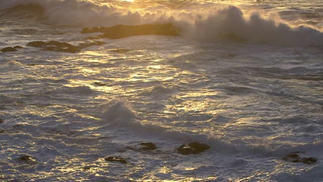 Waves roll onto the rocky coastline of El Hierro.