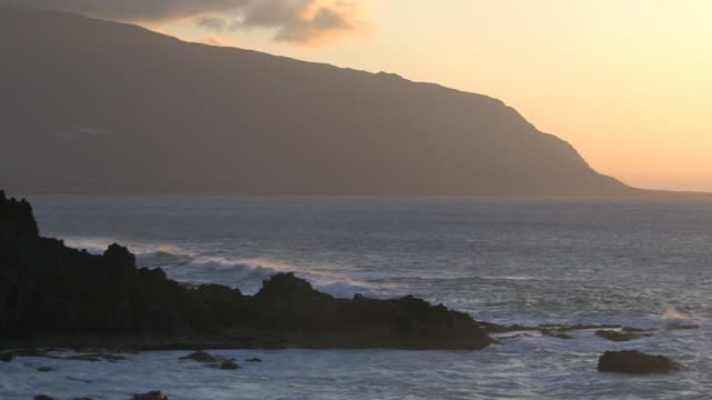 waves roll onto the rocky coastline of the island of el hierro. - spain stock videos & royalty-free footage