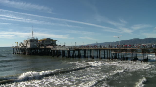 Waves rush under pier in Santa Monica