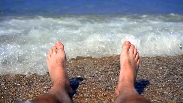waves sea splashing feet - slow motion