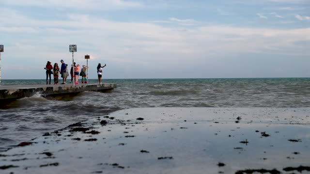 waves splash ashore from the strait of florida during the seasonal king tides on october 26 2019 in key west florida researchers estimate that the... - king tide stock videos & royalty-free footage