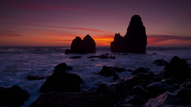 waves splash onto rocks at sunset on rodeo beach in marin county, california. - marin stock videos & royalty-free footage