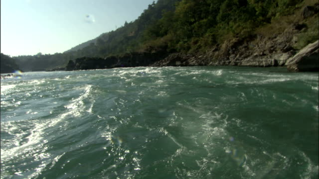 Waves splash over camera whilst rafting down River Ganges Available in HD.