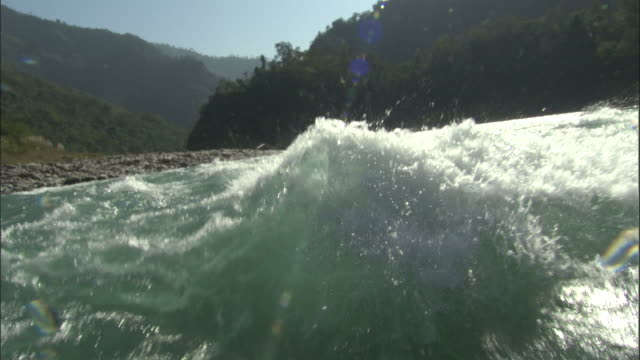 waves splash over camera whilst rafting down river ganges, india available in hd. - rafting stock videos & royalty-free footage