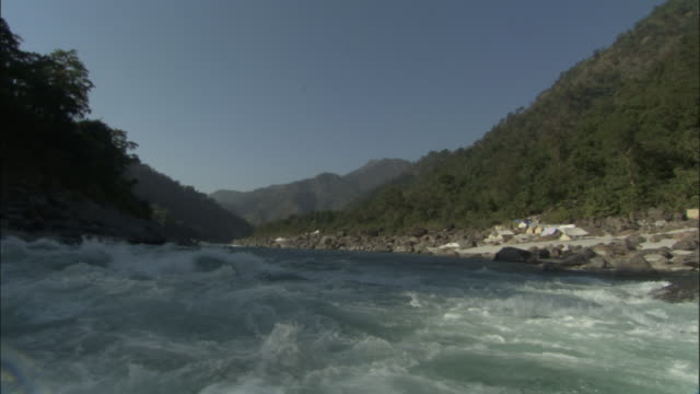 Waves splash over camera whilst rafting down River Ganges, India Available in HD.