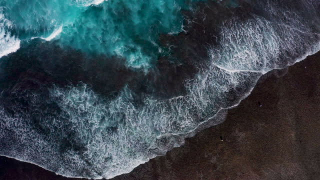 waves splashing along the coastline in bali - indonesia video stock e b–roll