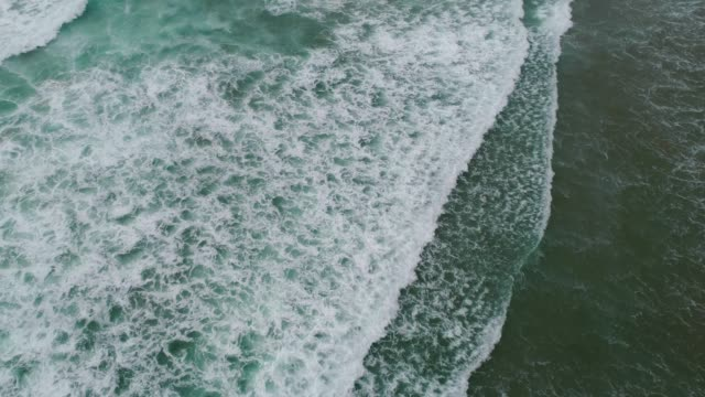 waves splashing at beach. - new zealand culture stock videos & royalty-free footage