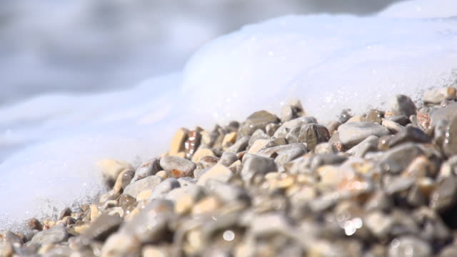 HD SUPER SLOW MO: Waves Splashing Pebble Beach