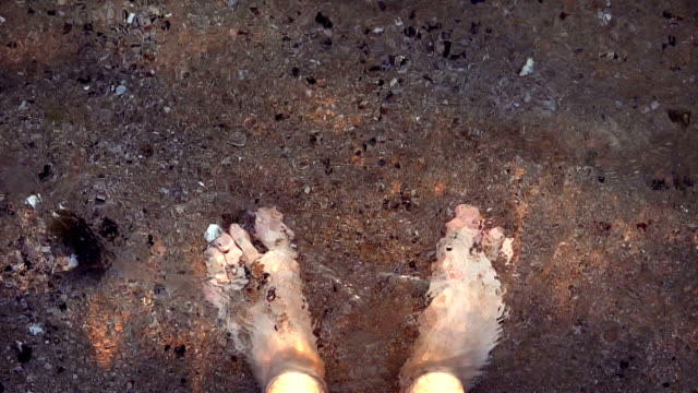 waves splashing water on man's feet by the sea - human toe stock videos and b-roll footage